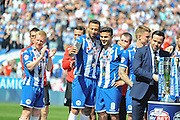 Wigan team mates Wigan Midfielder Sam Morsy and Wigan Striker Craig Davies  after Sky Bet League 1 match between Wigan Athletic and Barnsley at the DW Stadium, Wigan, England on 8 May 2016. Photo by John Marfleet.