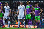 Stuart Dallas of Leeds United (15), Aapo Halme of Leeds United (52) get set to defend a free-kick, whilst Lloyd Kelly of Bristol City (17) and Tomas Kalas of Bristol City (22) are ready to attack during the EFL Sky Bet Championship match between Leeds United and Bristol City at Elland Road, Leeds, England on 24 November 2018.