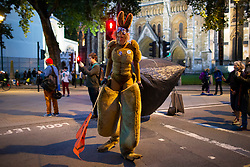 © Licensed to London News Pictures. 09/10/2019. London, UK. An Extinction Rebellion activist dresses as Kangaroos at a  roadblock in Westminster as police try to remove protesters. Police continue to attempt to clear roads in Westminster on the third day of the protest.  Photo credit: George Cracknell Wright/LNP