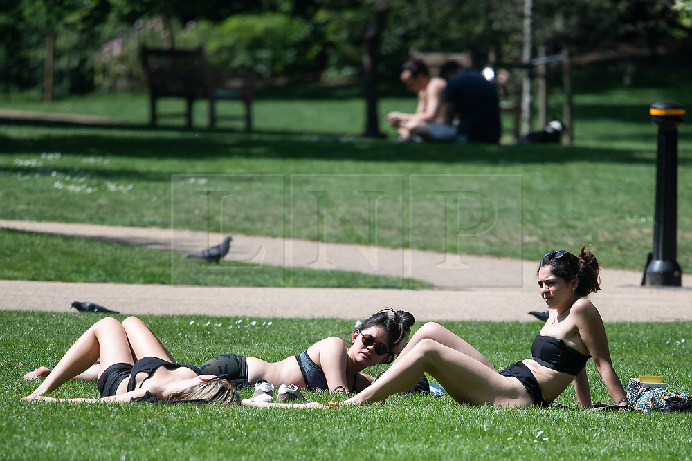 © Licensed to London News Pictures. 09/05/2020. London, UK. Three women sunbathe in St James's Park, central London during lockdown. The government is set to announce measures to ease lockdown, which was introduced to fight the spread of the COVID-19 strain of coronavirus. Photo credit: Ben Cawthra/LNP