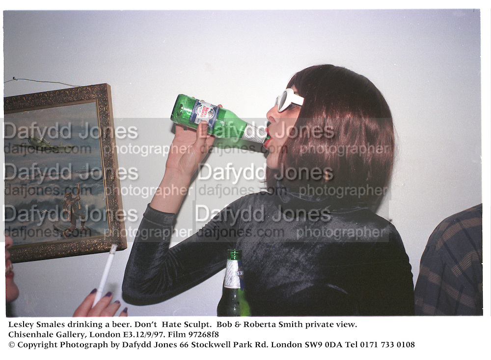 Lesley Smales drinking a beer. Don't  Hate Sculpt.  Bob &amp; Roberta Smith private view. Chisenhale Gallery, London E3.12/9/97. Film 97268f8<br />