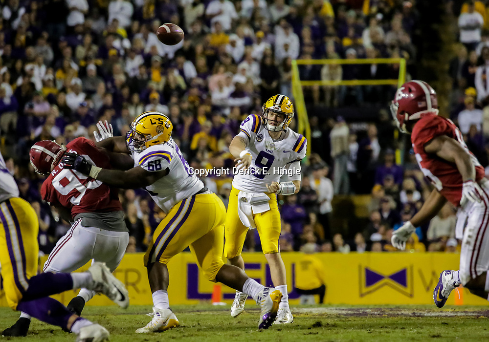 Nov 3, 2018; Baton Rouge, LA, USA; LSU Tigers quarterback Joe Burrow (9) throws against the Alabama Crimson Tide during the third quarter at Tiger Stadium. Mandatory Credit: Derick E. Hingle-USA TODAY Sports
