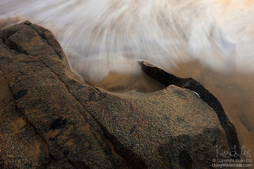 Pacific Ocean waves crash up against the rocky shoreline on a beach in Sayulita, Mexico.
