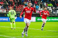 ALKMAAR - 27-01-2016, AZ - Cambuur, AFAS Stadion, 3-1, AZ speler Vincent Janssen heeft de 3-0 gescoord en juicht, SC Cambuur doelman Leonard Nienhuis (l), AZ speler Alireza Jahanbakhsh (r).