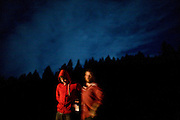 Blind Pilot drummer Ryan Dobrowski, left and vibes player Ian Krist, right, enjoy beers behind the Peg House after the show and a long day riding on Highway 101 in Leggett, CA on September 18, 2008.