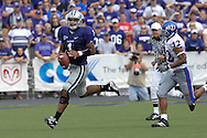 MANHATTAN, KS - OCTOBER 06:  Manhattan, KS - October 06:  Quarterback Josh Freeman #1 of the Kansas State Wildcats rolls outside against pressure from linebacker James Holt #12 the Kansas Jayhawks, during a NCAA football game on October 06, 2007 at Bill Snyder Family Stadium in Manhattan, Kansas.  Kansas won the game 30-24.  (Photo by Peter Aiken/Getty Images)