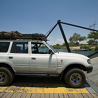 Africa, Botswana, Kasane, Toyota Land Cruiser is carried aboard river ferry across Zambezi River from Kazugulu, Zambia border crossing toward Botswana