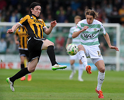 Yeovil Town's Sam Foley is tackled by Port Vale's Louis Dodds - Photo mandatory by-line: Harry Trump/JMP - Mobile: 07966 386802 - 25/04/15 - SPORT - FOOTBALL - Sky Bet League One - Yeovil Town v Port Vale - Huish Park, Yeovil, England.