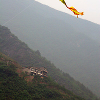 A Chinese kite flying along the Three Gorges of the Yangtze River.
