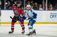 KELOWNA, BC - OCTOBER 16:  Ethan Regnier #18 of the Swift Current Broncos checks Alex Swetlikoff #17 of the Kelowna Rockets at Prospera Place on October 16, 2019 in Kelowna, Canada. (Photo by Marissa Baecker/Shoot the Breeze)