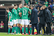 Northern Ireland players take a water break and speak with Northern Ireland manager Michael O'Neill during the UEFA European 2020 Qualifier match between Northern Ireland and Netherlands at National Football Stadium, Windsor Park, Northern Ireland on 16 November 2019.