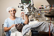 Dr Kris Rallah Baker in surgery with patient Nicholas Nabarawurr from Goulburn Island at Royal Darwin Hospital. Dr Baker is Australian's first indigenous eye doctor set to become an opthlamologist next year.