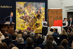 "© Licensed to London News Pictures. 10/02/2016. London, UK.  (L to R) Adrian Ghenie's ""The Sunflowers"" and Alberto Burri's ""Sacco e Rosso"", which sold for a hammer price of £14.2m and £8.0m respectively, at Sotheby's Contemporary Art evening sale in New Bond Street.   Photo credit : Stephen Chung/LNP"
