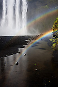A double rainbow appears near Skogarfoss waterfall. Rainbows are quite common in Iceland waterfalls because of the huge amount of water sparay