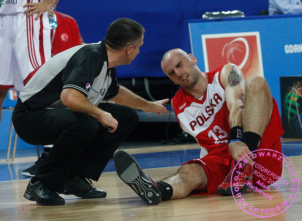 Wroclaw 09/09/2009.EuroBasket 2009.Preliminary Round - Group D.Poland v Turkey.Poland's Marcin Gortat injured ..Photo by : Piotr Hawalej / WROFOTO