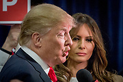 Presidential hopeful, billionaire Donald Trump with his wife Melania Trump in the spin room after the CNN Republican Presidential Debate at the Venetian Hotel and Casino in Las Vegas.