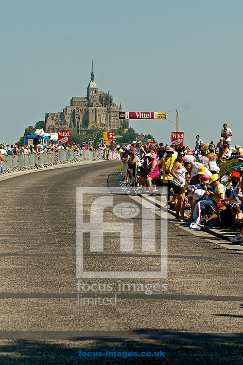 Picture by Ian Wadkins/Focus Images Ltd +44 7877 568959<br /> 10/07/2013<br /> Crowds line the final approach road to Mont Saint Michel, the destination for riders during stage 11 of the 2013 Tour de France in Mont Saint Michel, France.
