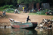 A fisherman cleans out his boat after a morning of work on Lake Victoria. Here in Ggaba, a small town in southern Uganda that almost entirely subsists on the fishing industry, the locals have contributed to the dangerous overfishing of the lake despite strict regulations from Tanzania, Uganda, and Kenya. Fishermen continue to keep fish that are far below the required minimum weight and employ dymanite and poison.