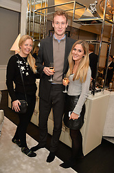 First look of the new Samsung Curved UHD TV at the Candy & Candy penthouse at No. 1 Arlington Street, London - an exclusive Samsung BlueHouse event held on 27th February 2014.<br /> Picture shows:-Left to right, ASTRID HARBORD, PATRICK CURTIS and LOTTIE BRADLEY.