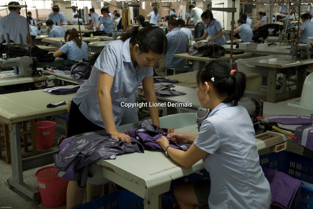 Women at work / Yingdak leather factory / China