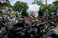 Tourists and parked motor bikes at Sanur. Bali revisited January 2012.
