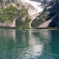 Glacier covered mountains reflect in the tranquil waters of the Northwestern Lagoon, a portion of the beautiful Kenai Fjords National Park, Alaska