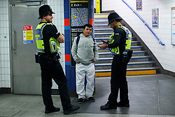 © Licensed to London News Pictures. 20/08/2016. London, UK. A tube passenger is being questioned after urinating on train tracks at Oxford Circus station during the night tube service on 20 August 2016. Transport for London started a 24-hour Tube service on Victoria and Central lines as demand has soared over recent years, with passenger numbers on Friday and Saturday nights up by around 70 per cent since 2000. The plan was announced in November 2013 and intended to begin in September 2015, but strikes over pay delayed the start by nearly another year. Photo credit: Tolga Akmen/LNP
