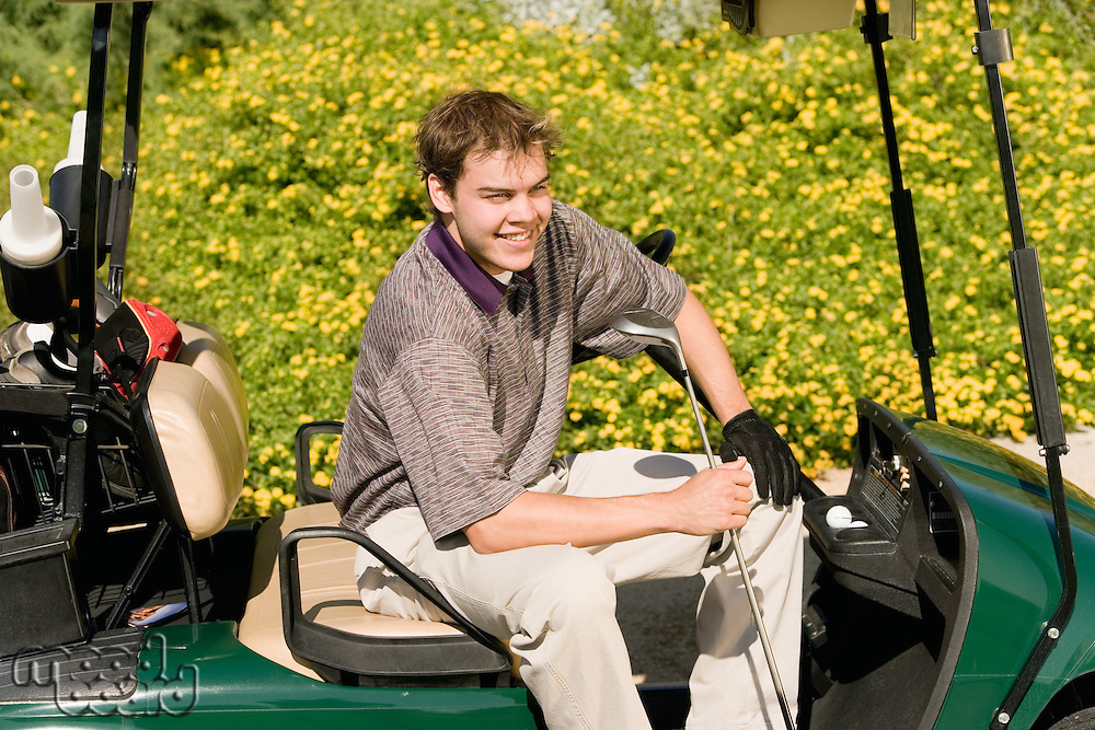 Golfer Sitting in Golf Cart