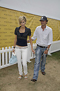 Lisa Butcher and William van Hage, Veuve Clicquot Gold Cup 2006. Final day. 23 July 2006. ONE TIME USE ONLY - DO NOT ARCHIVE  © Copyright Photograph by Dafydd Jones 66 Stockwell Park Rd. London SW9 0DA Tel 020 7733 0108 www.dafjones.com