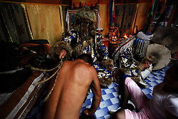 Mongolian Shaman Gankhuyag Batmunkh (back L) whips a worshipper who has come to seek penance for his wrongdoings while his brother Batgerel Batmunkh (R) and their sister, Munkhzul (front -R) looks on during a Shaman ceremony in their ger on the outskirts of Ulan Bator, Mongolia, 04 July 2012. Mongolian brothers Gankhuyag and Batgerel Batmunkh share a similar fate. Both were construction workers before fate calls on them to take on their Shamanic roles to serve the spirits. Shamanism comes from the term 'shamans' that refers to priests or mediums that acts as vessels for spirits, gods and demons to communicate with the human world. In Mongolia, they adhere to the ancient beliefs of Tengrism, where spirits live in all of nature, in the sun, moon, lakes, rivers, mountains, and trees.