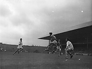 GAA All Ireland Minor Football Final Cork v. Galway 26th September 1960 Croke Park<br /><br />D.Moynihan (no. 14) Cork full forward gains possession of the ball near the Galway Goalmouth with M. Tierney, Galway full back on the right *** Local Caption *** It is important to note that under the COPYRIGHT AND RELATED RIGHTS ACT 2000 the copyright of these photographs are the property of the photographer and they cannot be copied, scanned, reproduced or electronically stored in any form whatsoever without the written permission of the photographer  26th September 1960<br /> <br /> All Ireland Minor Football Final between Cork and Galway at Croke Park.