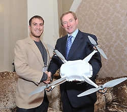 Adam Rice from US Company Skycatch and An Taoiseach Enda Kenny at the Mayo.ie Date & Drones Conference at Breaffy House Hotel on friday last .<br /> Pic Conor McKeown