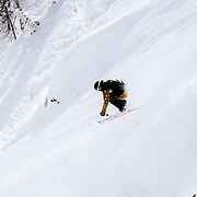 Hadlley Hammer drops a cliff in-bounds in the Alta 0 closure - open because of snowfall totals.