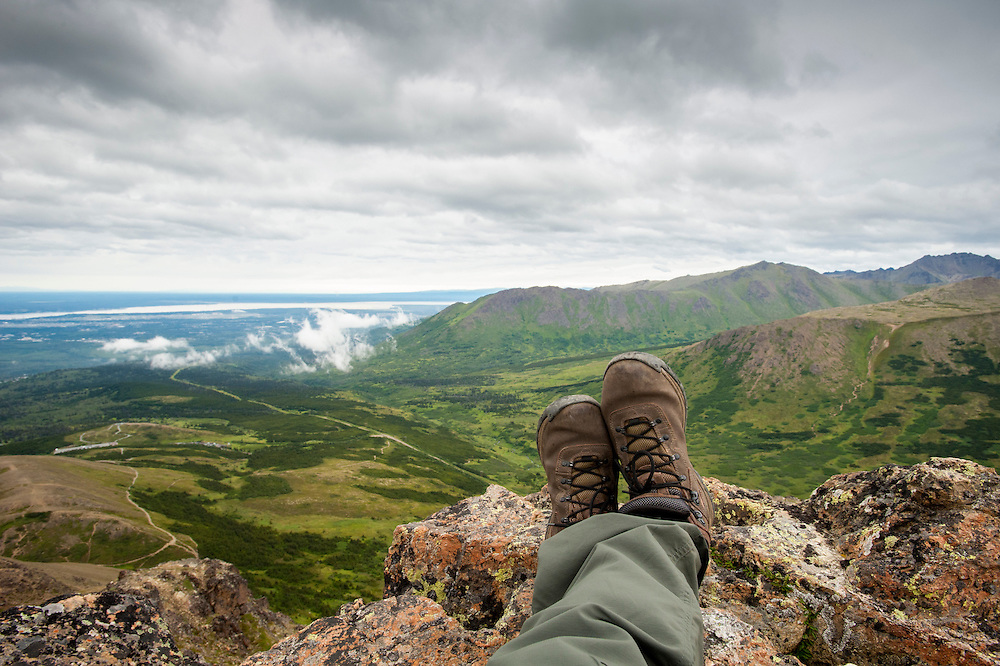 Climbers legs and feet on top of Flat Top Mountain trail, near Anchorage AK,  Chugach Mountains.