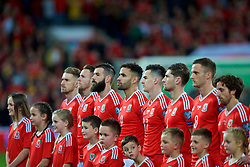 CARDIFF, WALES - Monday, October 9, 2017: Wales players stand for the national anthem before the 2018 FIFA World Cup Qualifying Group D match between Wales and Republic of Ireland at the Cardiff City Stadium. Aaron Ramsey, Chris Gunter, Joe Ledley, Hal Robson-Kanu, Tom Lawrence, Ben Davies. (Pic by Paul Greenwood/Propaganda)