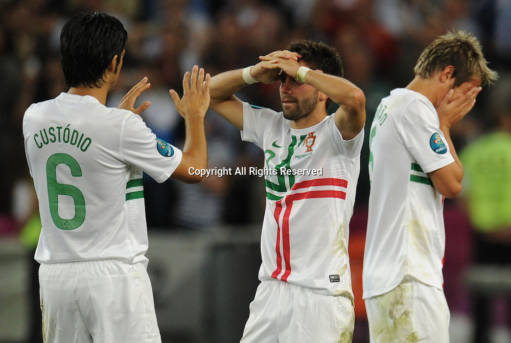 27.06.2012. Donetsk, Ukraine.  Portugal's Custodio (L-R), Joao Moutinho and Fabio Coentrao react after the end of the penalty shoot-out UEFA EURO 2012 semi-final soccer match Portugal vs Spain at Donbass Arena in Donetsk, Ukraine, 27 June 2012.