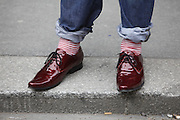 Man attends the funeral procession of Baroness Thatcher wearing shiny red shoes similar to those worn in The Wizard of Oz in a homage to the song 'Ding Dong The witch is dead'...The Strand, Central London, UK. .17th April 2013..Photo by Zute Lightfoot. www.lightfootphoto.com 07514530425.