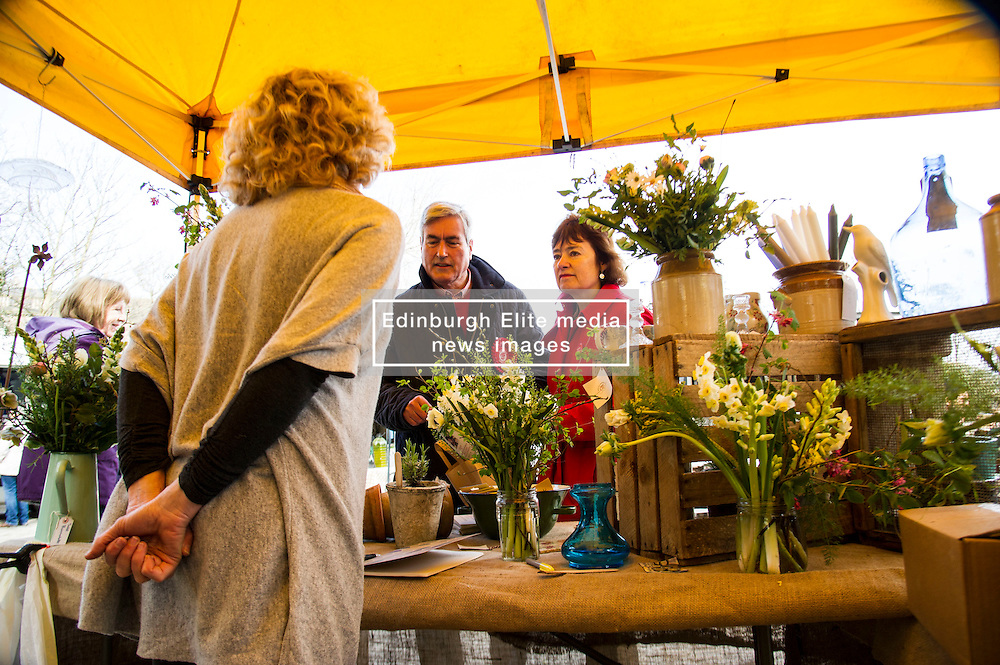 Pictured: Ian Gray and Sarah Boyack visited the Sweet Pea Studio stall to check out their wares<br /> <br /> The former Scottish Labour leader Iain Gray joined colleague Sarah Boyack activists and supporters at a street stall at Stockbridge Market. <br /> Ger Harley   EEm 10 April 2016