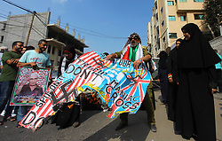 October 8, 2018 - Gaza City, Gaza Strip, Palestinian Territory - Palestinians burn an Israeli, British and U.S. flags during a protest to show solidarity with Palestinian prisoners held in Israeli jails, in front of Red cross office in Gaza city on October 8, 2018  (Credit Image: © Mahmoud Ajjour/APA Images via ZUMA Wire)