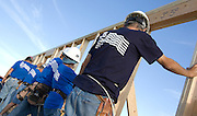 Habitat for Humanity Tucson volunteers raising walls on a new house.