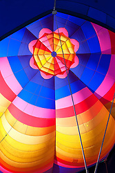 The inside of a pastel colored hot air balloon
