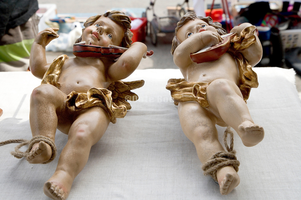 two music playing cherubs displayed at a flee market