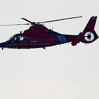 The US Coast Guard 6590 HH-65C Dolphin (SA-366G-1) (cn 6291) helicopter over Sandy Hook Bay exiting after running drills with a motor life boat.   This helicopter is ased in Atlantic City