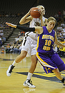 December 22 2010: Iowa guard Jaime Printy (24) puts up a shot over Northern Iowa guard Jacqui Kalin (10) during the first half of an NCAA college basketball game at Carver-Hawkeye Arena in Iowa City, Iowa on December 22, 2010. Iowa defeated Northern Iowa 75-64.