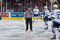 KELOWNA, CANADA - OCTOBER 4: Referee Nick Panter stands at centre ice between the Kelowna Rockets and the Victoria Royals on October 4, 2017 at Prospera Place in Kelowna, British Columbia, Canada.  (Photo by Marissa Baecker/Shoot the Breeze)  *** Local Caption ***