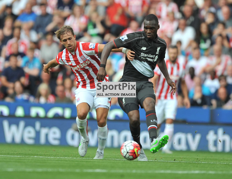Stokes Marc Muniesa holds of Liverpools Benteke, Stoke City v Liverpool Premiership Brittania Stadium, Sunday 9th August 2015