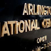 The gold and black sign at the entrance of Arlington National Cemetery in Arlington, Virginia.