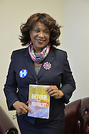 "Garden City, New York, USA. April 17, 2016. BERNICE SIMS, a campaign volunteer for Democratic presidential primary candidate Hillary Clinton, is wokring at the Canvass Kickoff at the Nassau County Democratic Office. Ms. Sims is a social worker, civil rights activist and author of the  2014 book ""Detour Before Midnight"" - her personal account of the last hours she and her family were with the Mississipi Burning civil rights workers killed by the KKK in 1964."