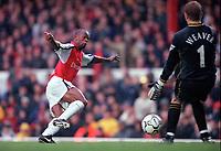 Sylvian Wiltord slips the ball between  Manchester City goalkeeper Nicky Weavers legs for the 3rd Arsenal goal. Arsenal v Manchester City, F.A.Carling Premiership, 28/10/2000. Credit Colorsport / Stuart MacFarlane.