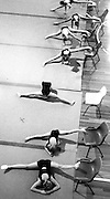 Rythmic gymnasts stretch before their training session at the State Sports Centre at Homebush Bay.<br /> Commissioned by Sydney Morning Herald